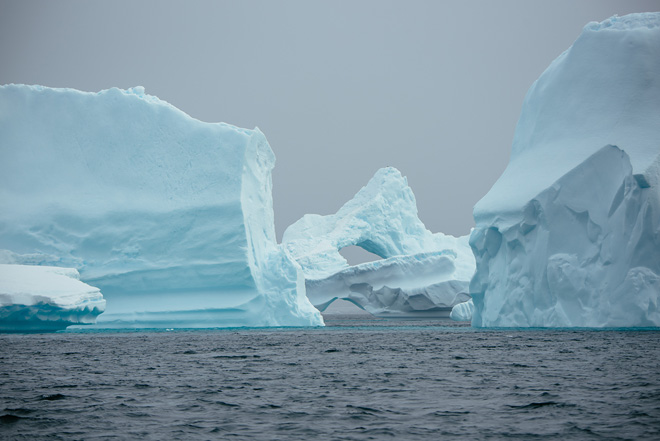 Double iceberg arch in Antarctica